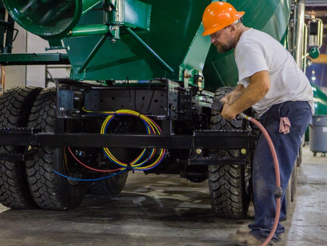 Continental Mixer employee assembling mixer truck.